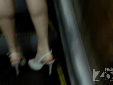 Hidden-Zone.com-Up1820# A girl in a short white dress. My attention was drawn to her shapely legs. Nice ass in whi