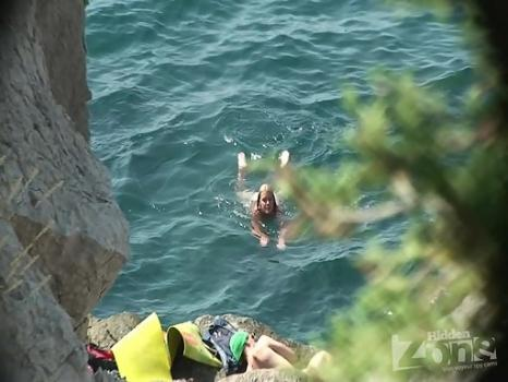 Hidden-Zone.com-Nu1217# We continue to see a young girl on a nudist beach. She decided to jump off a cliff into th
