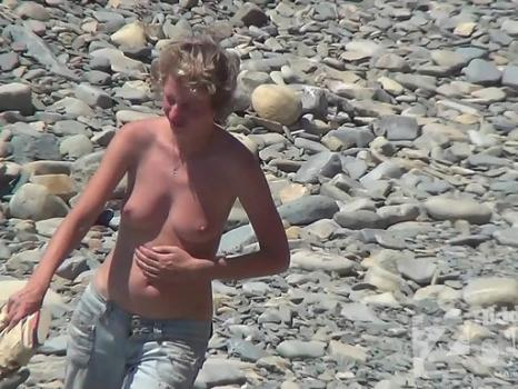 Nu1410# On the beach there are new actors - another company of nudists. Young girls and boys. Girl